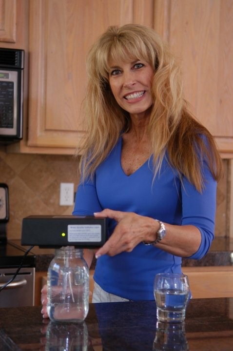 Woman using Micro-Particle Colloidal Silver Generator from The Silver Edge