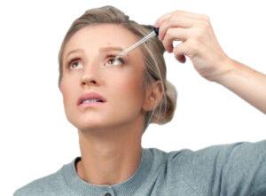 Woman Using an Eyedropper