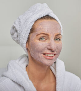 Woman with a natural homemade colloidal silver face mask on
