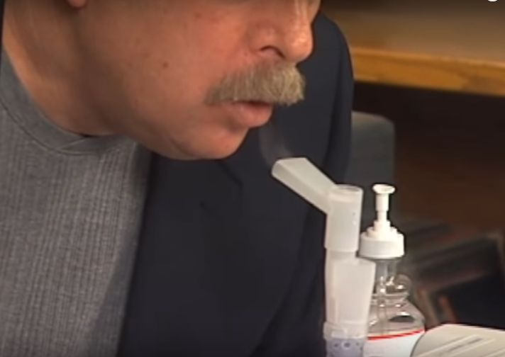 Steve Barwick using a nebulizer with colloidal silver