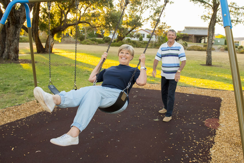 Relief from hemorrhoids with colloidal silver - two adults playing on a swingset