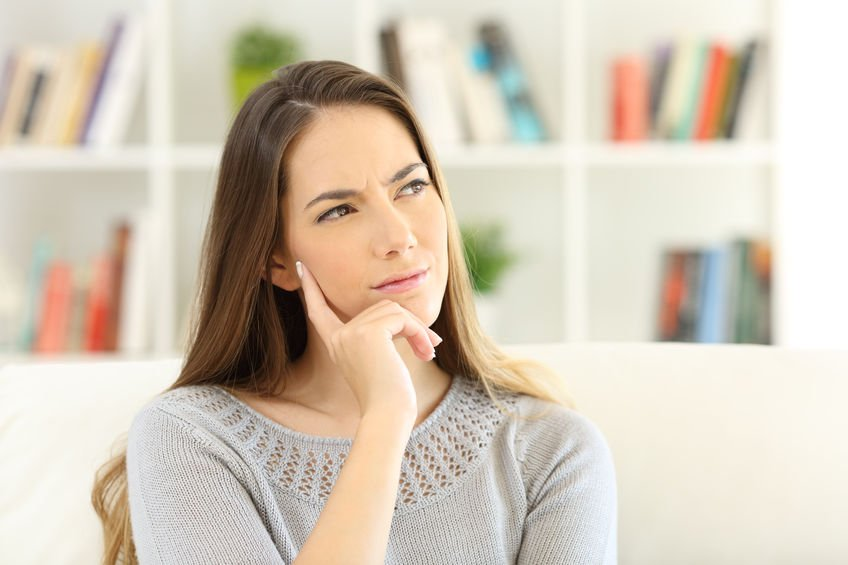 Woman wondering sitting at home