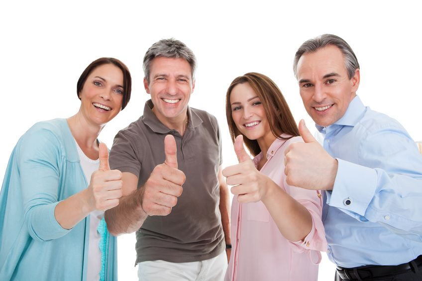 Group of happy people showing thumbs up - Real Stories: Colloidal Silver and Kidney Infections