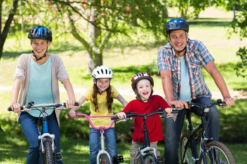 Happy family on their bike at the park on a sunny day - Relief from Urinary Tract Infections with Colloidal Silver
