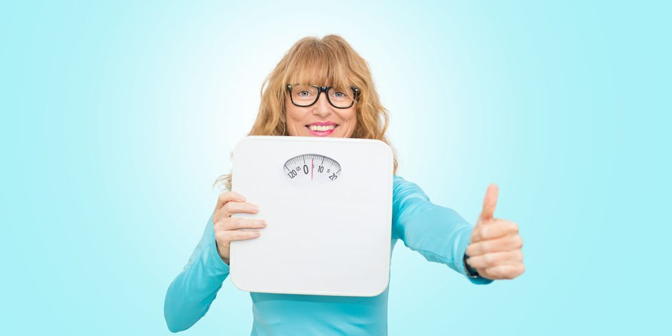 woman with scales, concept of diet and beauty - Can Colloidal Silver Help You Lose Excess Weight?