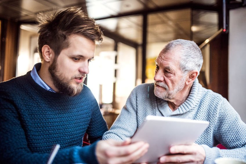 father and son with tablet - Know A Colloidal Silver Skeptic? Share These Resources!