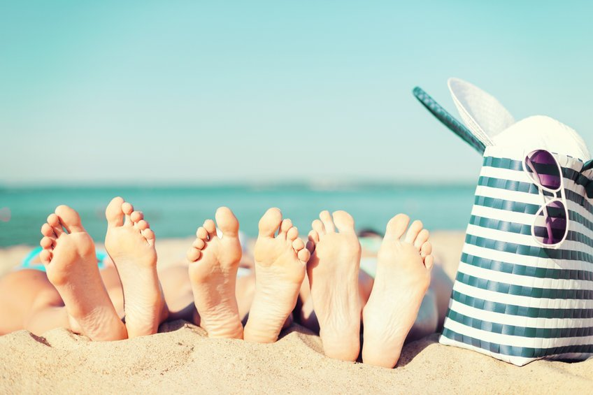 three women lying on the beach - Is Colloidal Silver Effective for Athlete's Foot?