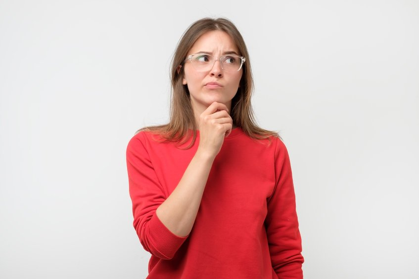 Doubtful woman looking with disbelief expression aside - Why Does Our Micro-Particle Colloidal Silver Generator Have a Bubbler Tube?